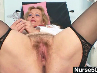 Obscene mature lady playthings her hairy peach near speculum